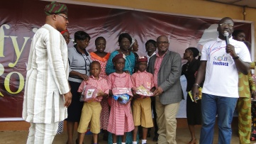 Tutor-Genera, Education District II, Barr. Titilayo Sholarin, Hon. Nurudeen Solaja (left) and other guests joining Hon. Agunbiade in presenting school uniforms and other gift items to the pupils of Jamatul Islamiyah Primary School, Ikorodu during his 52 birthday celebration